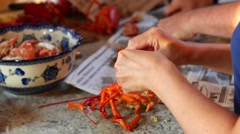 People crack open lobsters for dinner Stock Footage