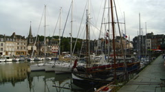 France - Honfleur - Reflection of Historic Buildings and Boats in Beautiful H Stock Footage