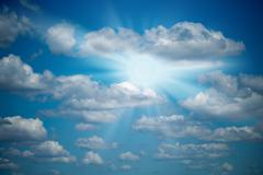 Easy clouds and the sun in the sky. - stock photo