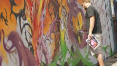 Upfest 2015 in Bristol: street artist making mural Stock Footage