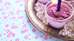 Homemade blueberry popsicles made in plastic cups. Stock Footage
