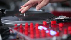 Hands of a Disc Jockey on the Professional Mixing Controller Arkistovideo