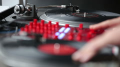 Hands of a Disc Jockey on the Professional Mixing Controller Stock Footage