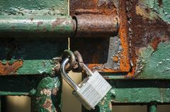 Iron latch and padlock - stock photo