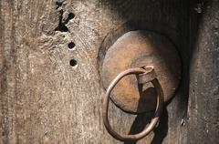 Iron fitting hardware on door Stock Photos