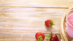 Homemade strawberry popsicles made in plastic cups. Stock Footage