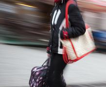 woman at rush hour walking in the street - stock photo