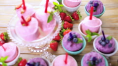 Homemade blueberry and strawberry popsicles made in plastic cups. Stock Footage
