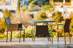 Home Exterior With Table And Chairs In Wooden Terrace Stock Photos