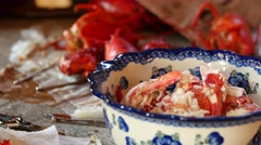 Person cracks open lobsters for dinner Stock Footage