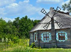 Authentic Ukrainian ancient house with thatched roof. Stock Photos