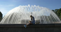 Holiday with book at the fountain Stock Footage