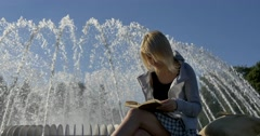 Woman Reading Stock Footage