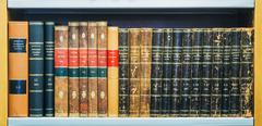 Old Vintage Books On Wooden Shelfs In Library - stock photo