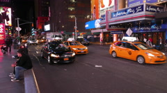 NYPD and yellow cabs in Manhattan at Times Square by night Stock Footage