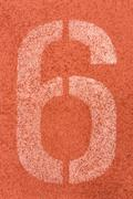 Number six on the start of a running track - check my portfolio for other num - stock photo
