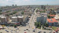 Pristina traffic on Bulevardi Deshmorete Kombit Stock Footage