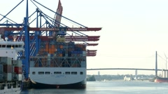 TL 4K Port of Hamburg Harbour Cargo goods loading on OOCL at Container Terminal Stock Footage