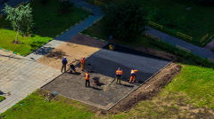 Workers laying road surface asphalt Stock Footage