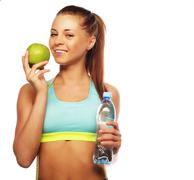 Healthy woman with water and apple diet smiling - stock photo