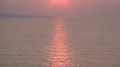 Time Lapse Sea Sunset Red Sun Water Waves Refection Island View Skyline Ocean - stock footage