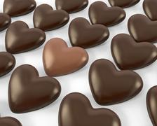 Heart shaped milk chocolate candy between dark ones - stock illustration