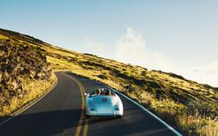 Coupe Driving on Country Road in Vintage Sports Car Stock Photos