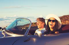 Stock Photo of Young Couple in Classic Vintage Sports Car