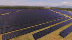 AERIAL: Huge power plant of photovoltaic cells and solar panels Stock Footage