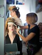 Backstage hairdressing fashion with make-up artist Stock Photos