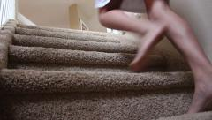 Low angle of girl walking up carpeted stairs Stock Footage