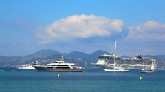 Luxury yachts and Cruise Ship in Cannes, France Stock Footage
