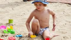 Children playing in the sand with buckets and shovels Stock Footage