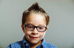 closeup portrait of cute boy wearing glasses - stock photo