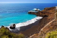 Beach el Bollullo black brown sand and aqua water Stock Photos