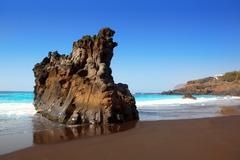 Beach el Bollullo black brown sand and aqua water - stock photo