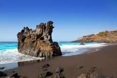 Beach el Bollullo black brown sand and aqua water Stock Photos