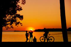 People enjoying sunset - stock photo
