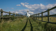 Pathway to small country church, time lapse zoom out - stock footage