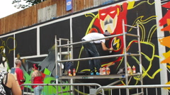 Stock Video Footage of Up fest 2015 Bristol from 25th – 27th July: street artist making graffiti