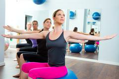 Pilates aerobic women group with stability ball - stock photo