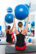 Stability ball in women Pilates class rear view Stock Photos
