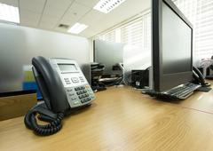 Table work in office with telephone and computer pc Stock Photos