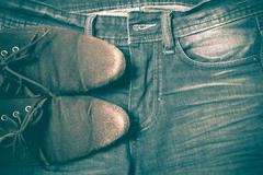 leather shoes on jean pant retro vintage style - stock photo