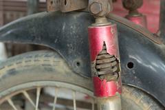 Motorcycle chock absorber rusty crack broken Stock Photos