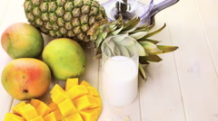 Fresh ingredients on the table to make smoothie with tropical fruits. Stock Footage