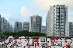 Graffiti on textured wall - stock photo