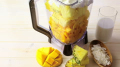 Homemade mango and pineapple smoothie made with coonut milk Stock Footage