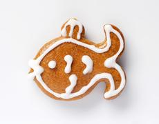Gingerbread cookie in the shape of a carp - stock photo