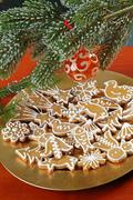 Christmas gingerbread gookies. under evergreen branch Stock Photos